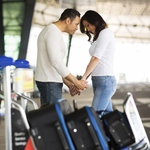 Couple Saying a Sad Goodbye at An Airport or Railway Station.
