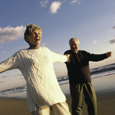 Old Couple Playing on the Beach