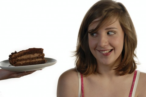 A Girl being Tempted with a Slice of Chocolate Cake