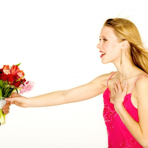 A Woman Is Flattered, When Receiving Some Flowers