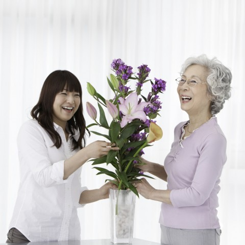 A Young Lady and An Old Lady with Flowers