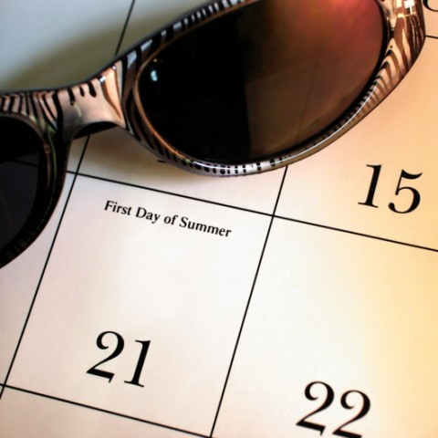 Sunglasses laying on calendar