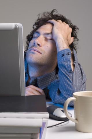 Man Falling Asleep at Computer