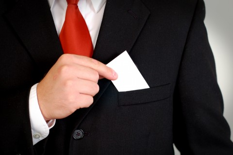 Man Putting Business Card in Pocket