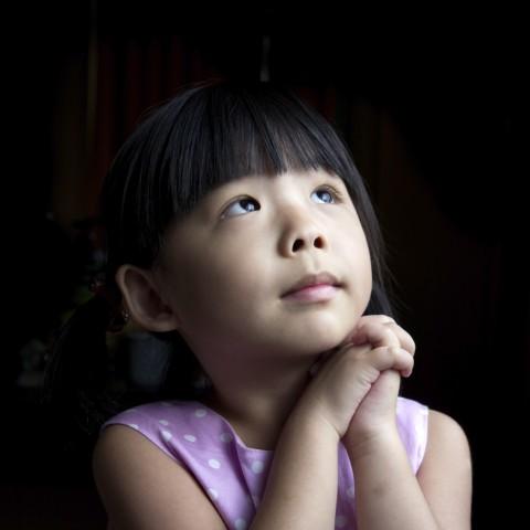 Child Making a Wish