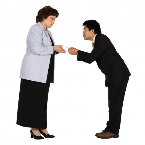 Man Giving Woman a Business Card