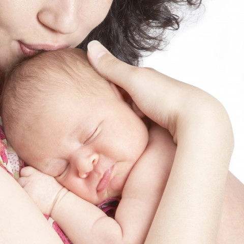 Newborn in Mother's Arms