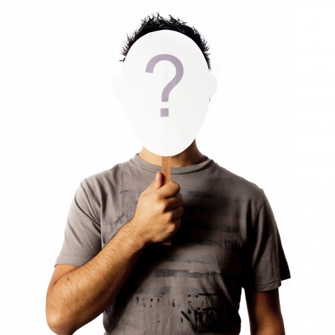 Man Holding Question Mark Sign in Front of Face