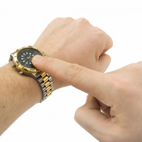 Man Pointing at Watch