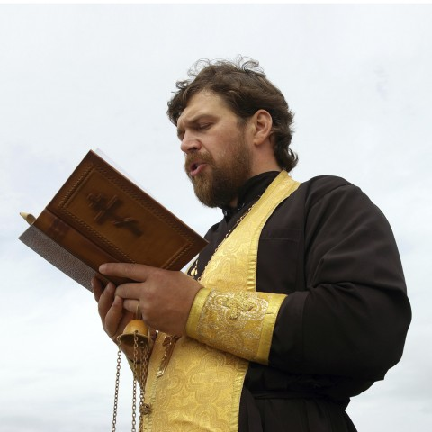 Priest Reading from the Bible