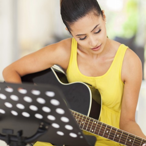 Woman Playing an Instrument