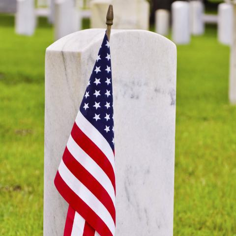 A Small American Flag in Front of a Veteran's Tombstone