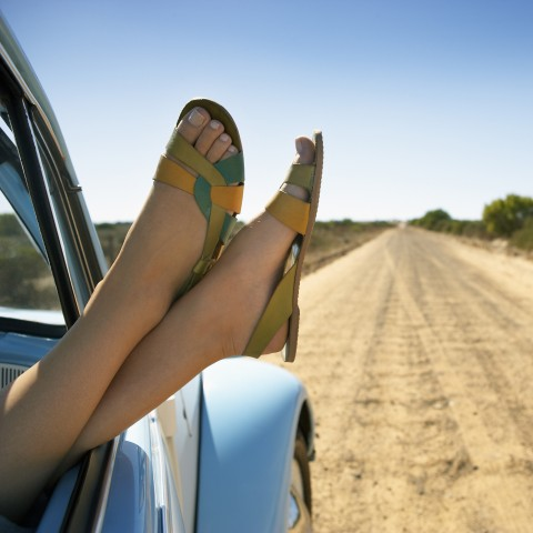 Woman With Feet Out Car Window