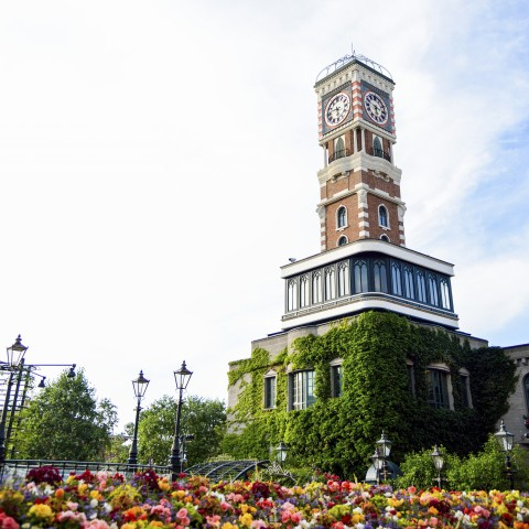 Clock Tower Surrounded by Flowers