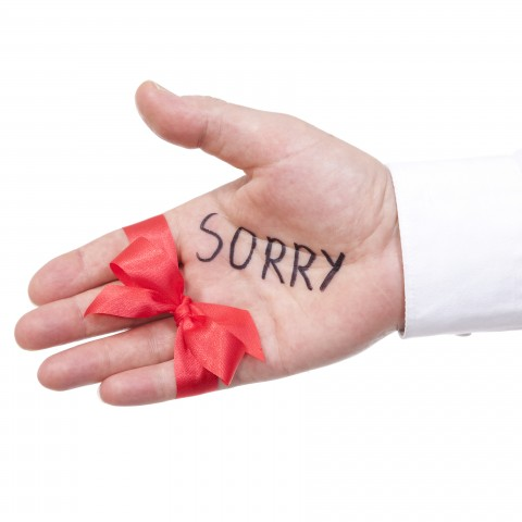 Hand with Sorry Written on It