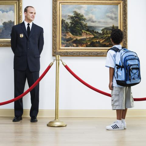 Boy Looking at Painting in Museum