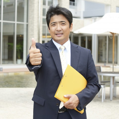 Man in Suit Thumbs Up