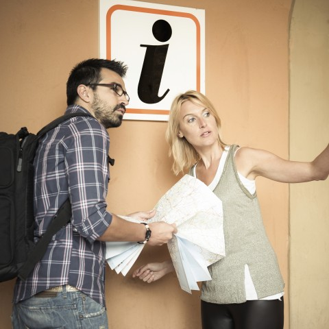 MAN TAKING DIRECTIONS FROM WOMAN