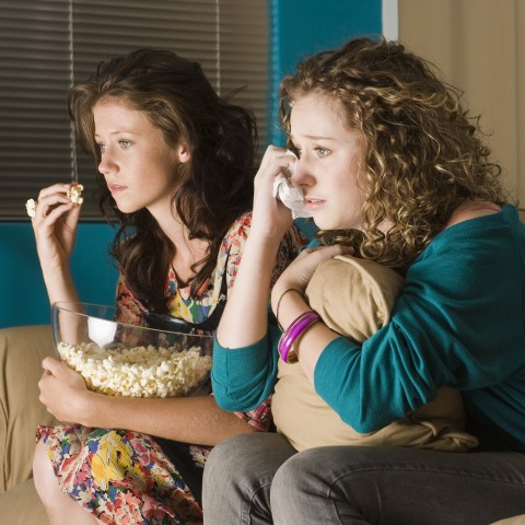Two Women Watching TV with Popcorn