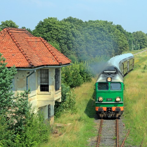A Train Passing A House