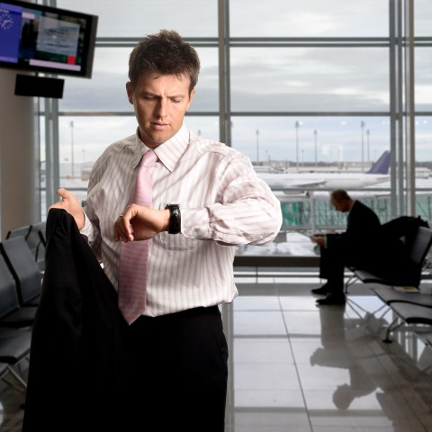 Businessman Looking at His Watch, Ready to Leave Work.
