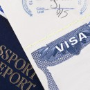"An Official Document with the Writing ""Visa."""