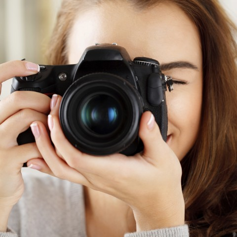 A Lady Holding a DSLR Camera