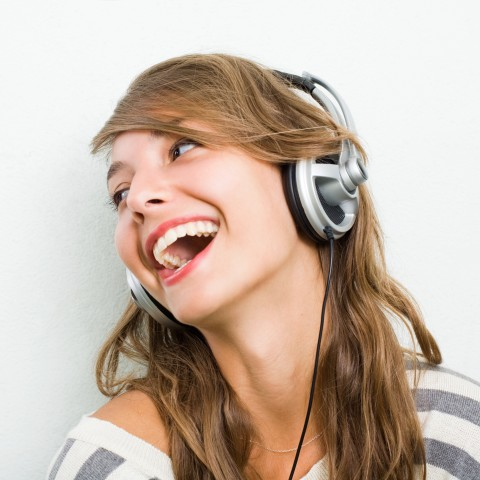 Girl Singing with Earphones On