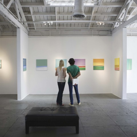 A Couple Looking at Paintings