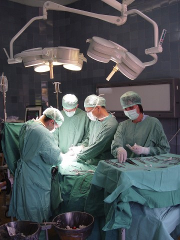 Doctors Around Operating Table in Theater