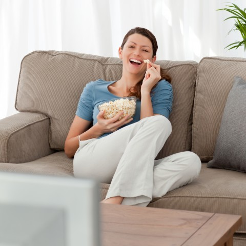 Woman Laughing at TV