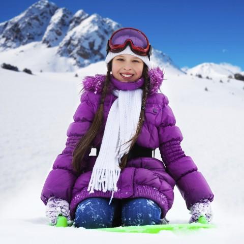 Woman in Snow Wearing Purple Coat
