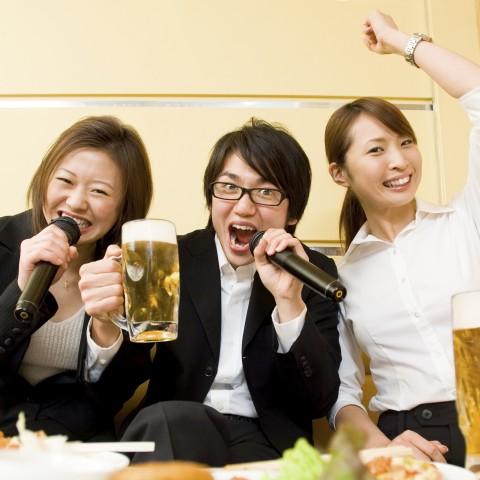 Two Asian Girls and a Guy Singing Karaoke