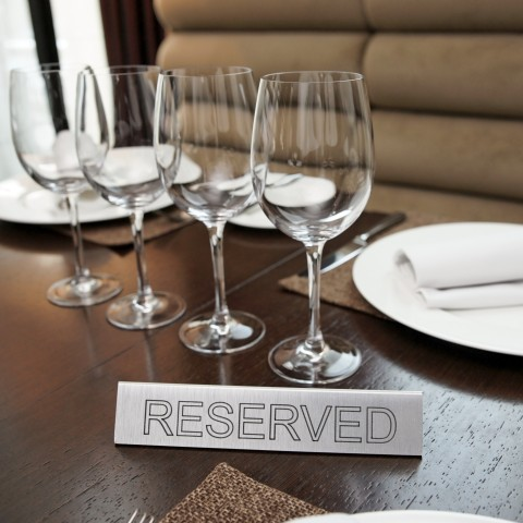 Table with Reserved Sign On It