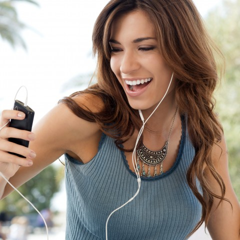 A Woman Listening to Music with Earbuds