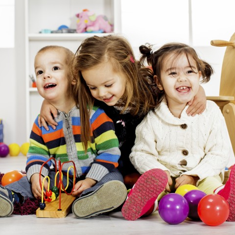 Three Young Children Smiling