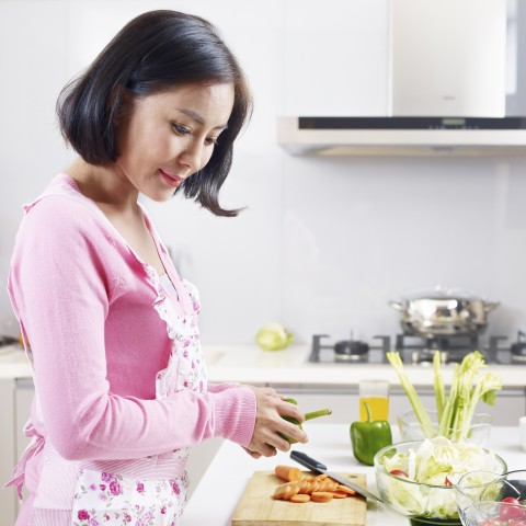 A Thai Woman Cooking Food