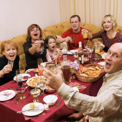 Family Celebrating Around A Table