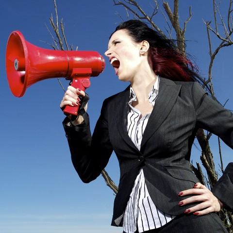 Woman Speaking Through Airhorn
