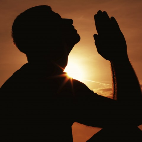 Silhouette of Man Praying for Repentance