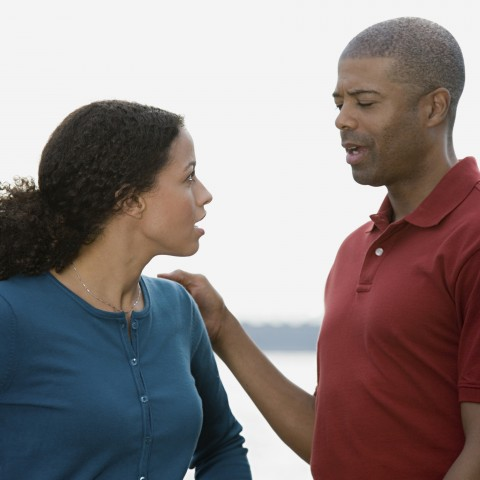 Man and Woman Having Uncomfortable Conversation