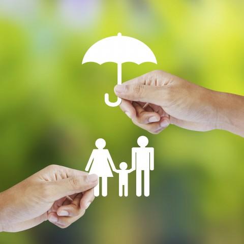 Cut-out Figures Under Cut-out Umbrella