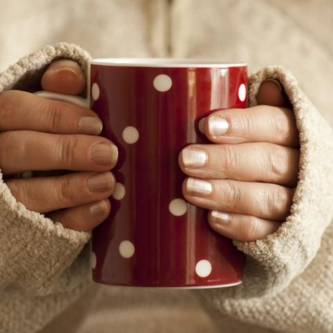 Woman olding Red Polkadot Coffee Mug