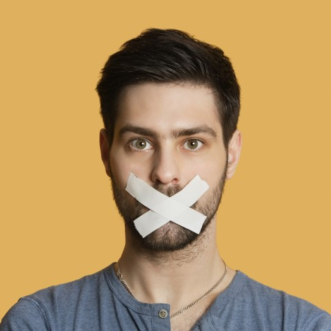 Man with Tape Covering His Mouth