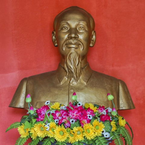 Ho Chi Mihn statue with flowers