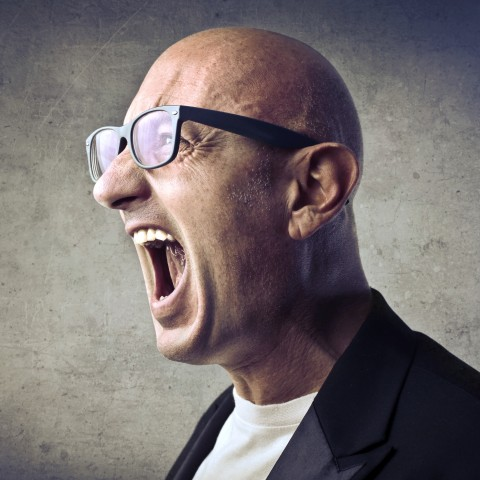 Bald Man Shouting at Someone