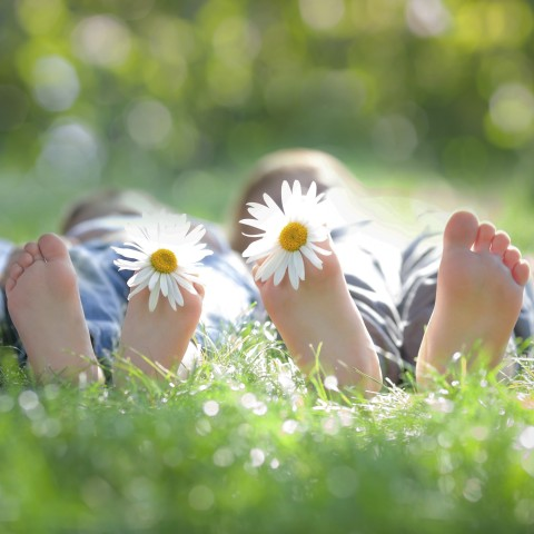 Two Children's Feet with Flowers