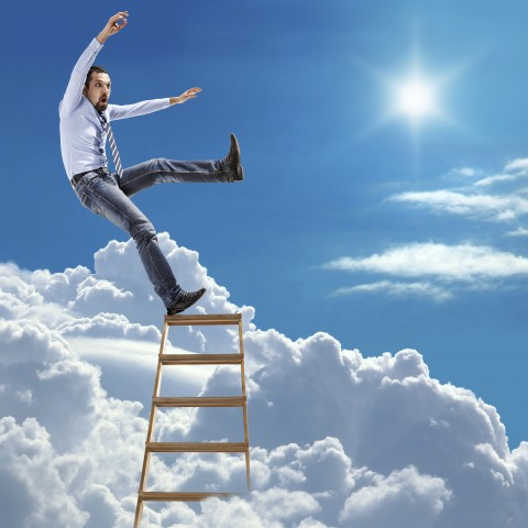 man on the top rung of a ladder in the sky, about to topple off