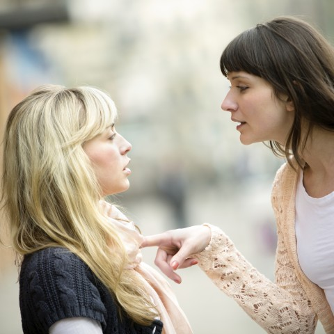 Woman Talking Down to Another Woman