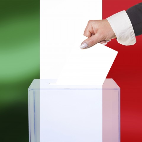 Someone Holding Paper in Front of Italian Flag